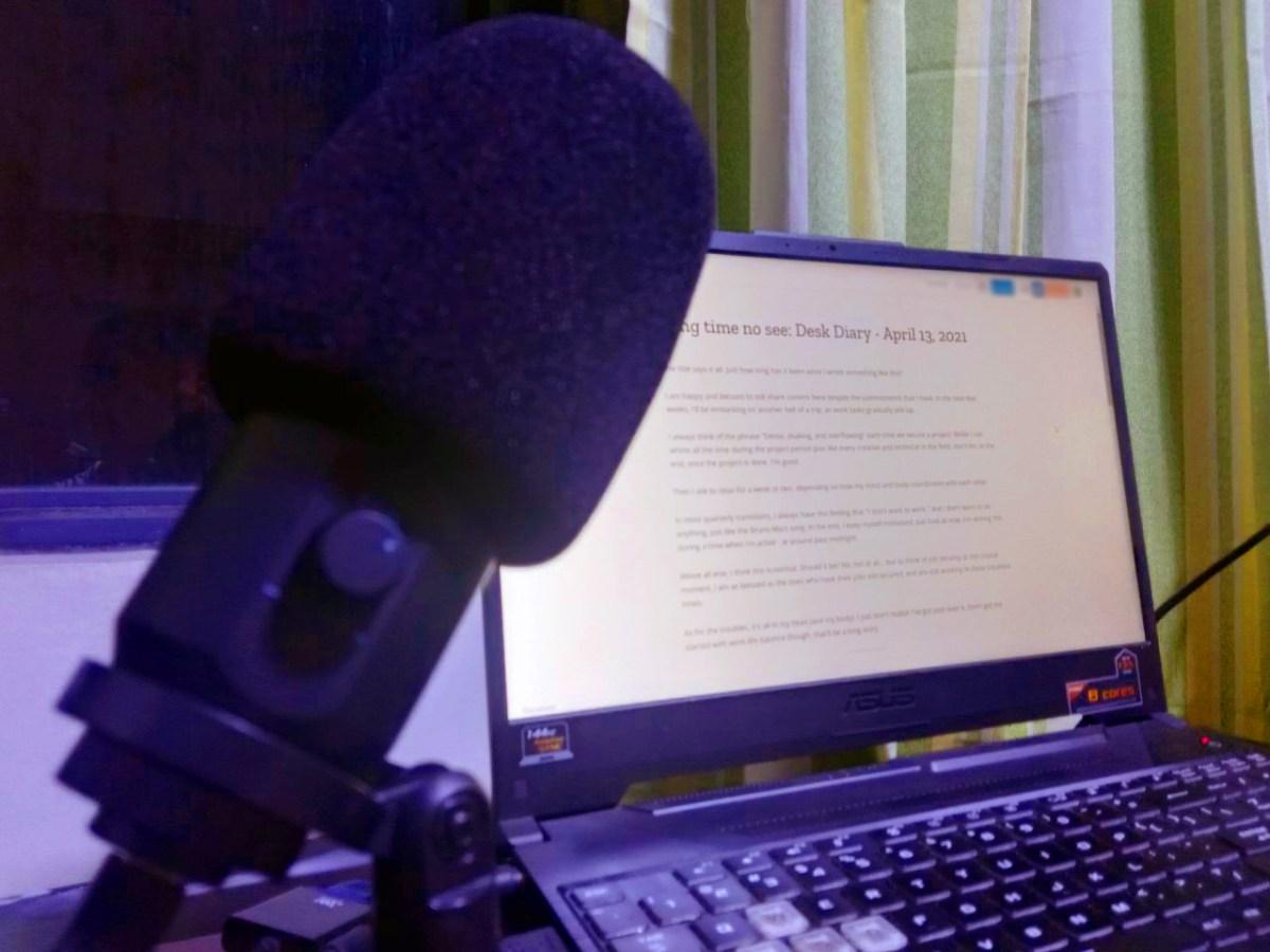Maono desktop microphone beside my current workspace.