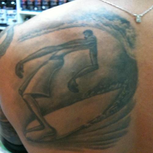 Solitube-surf-art-tattoo