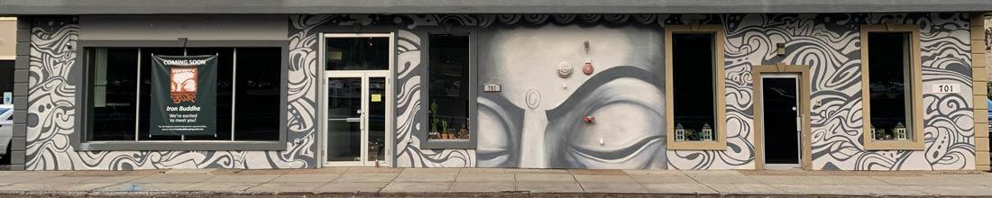 Iron Buddha street art wall by Jay Alders
