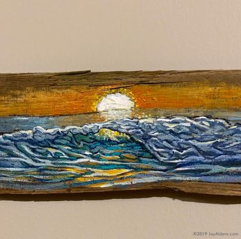 stylized contemporary ocean wave painting on driftwood