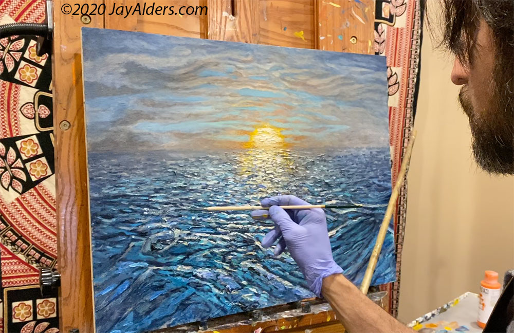 Jay Alders painting a seascape