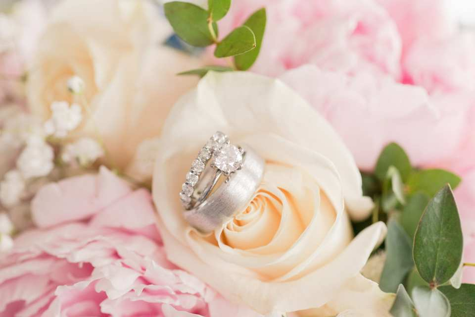 classy wedding rings and roses