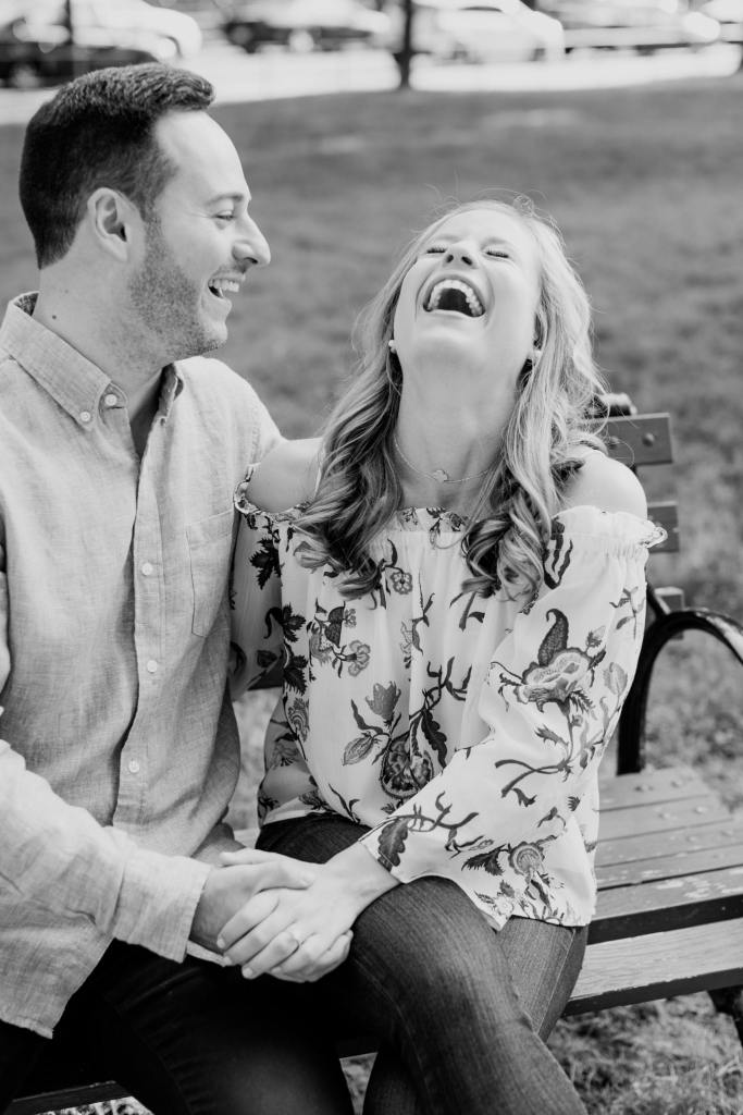 fun loving couple engagement shoot, black and white photo