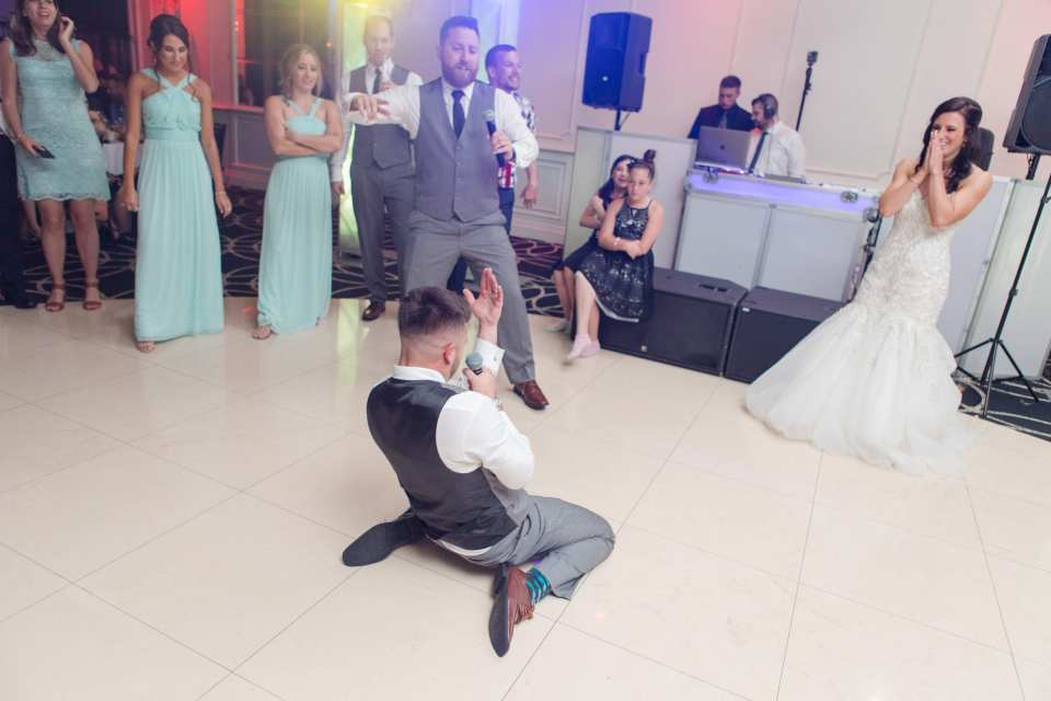 groom sings to bride, bride serenaded by groom, fun wedding photos