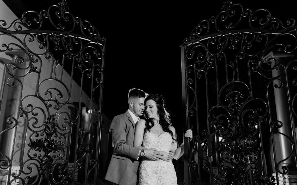 glamorous bride and groom at night, bride and groom at the gate, the gate at the Gramercy, the gate at the Gramercy at Lakeside Manor