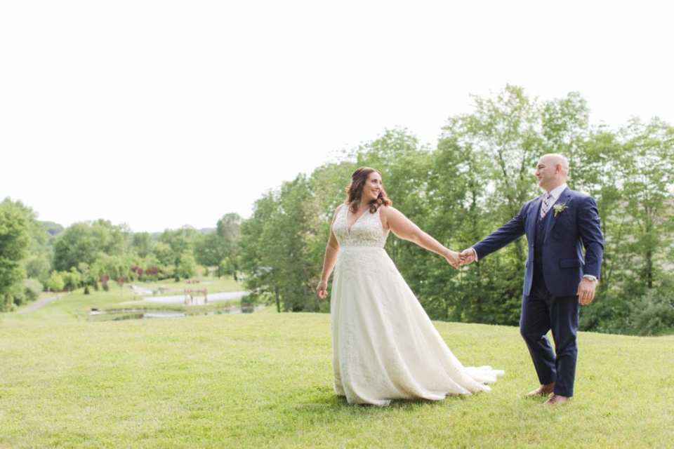 bride and groom on top of mountain at bear brook valley
