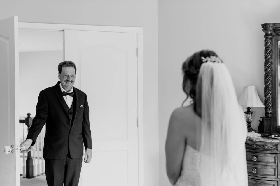 father of the bride moment, black and white, father sees bride for the first time