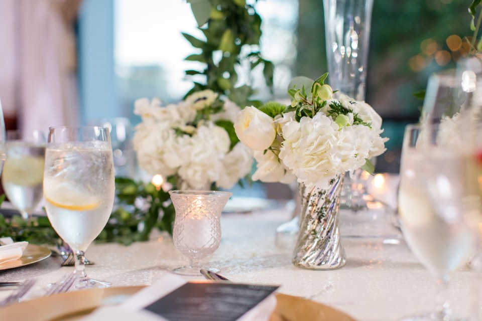 classy short wedding reception floral arrangements, small rose and carnation and hydrangea wedding arranements