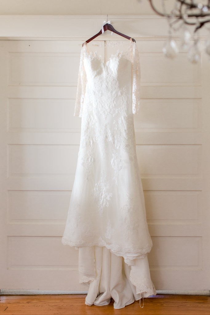 bridal gown on display photo, lace long sleeve bridal gown, Pronovias, NJ wedding photographer