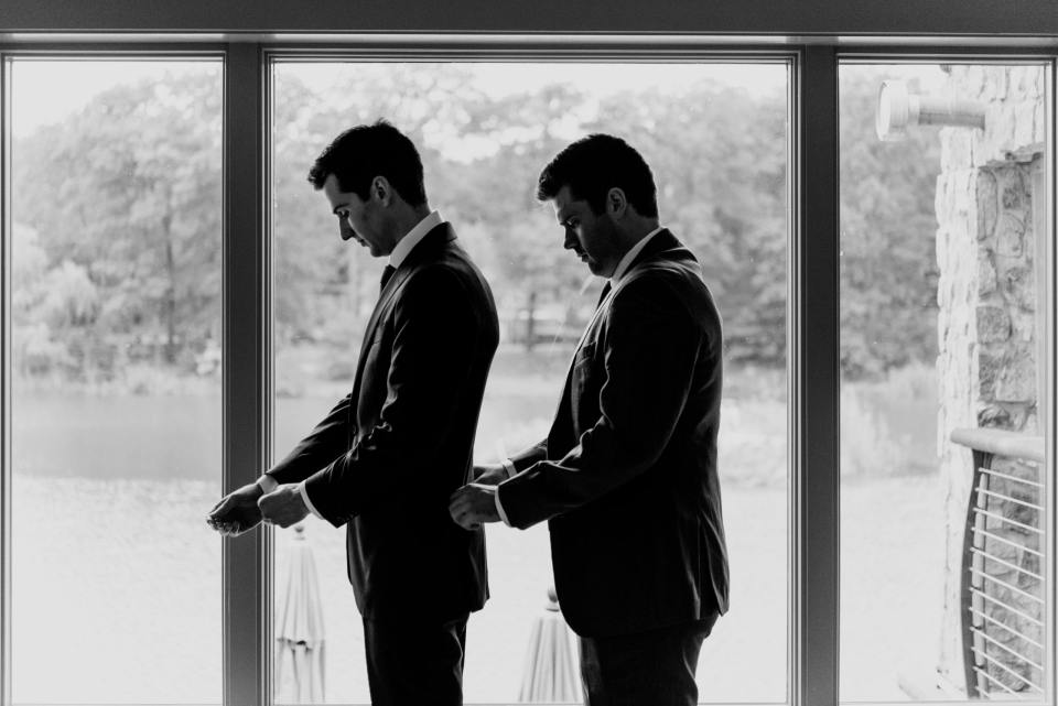black and white groom prep shot, groom and best man
