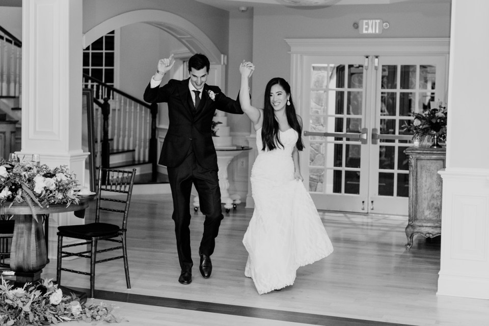 bride and groom enter at the Rock Island Lake Club, NJ wedding photographer