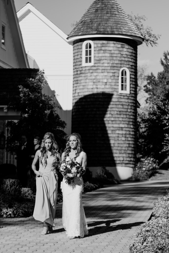 bride and her sister black and white candid, Ryland Inn, NJ wedding photographer