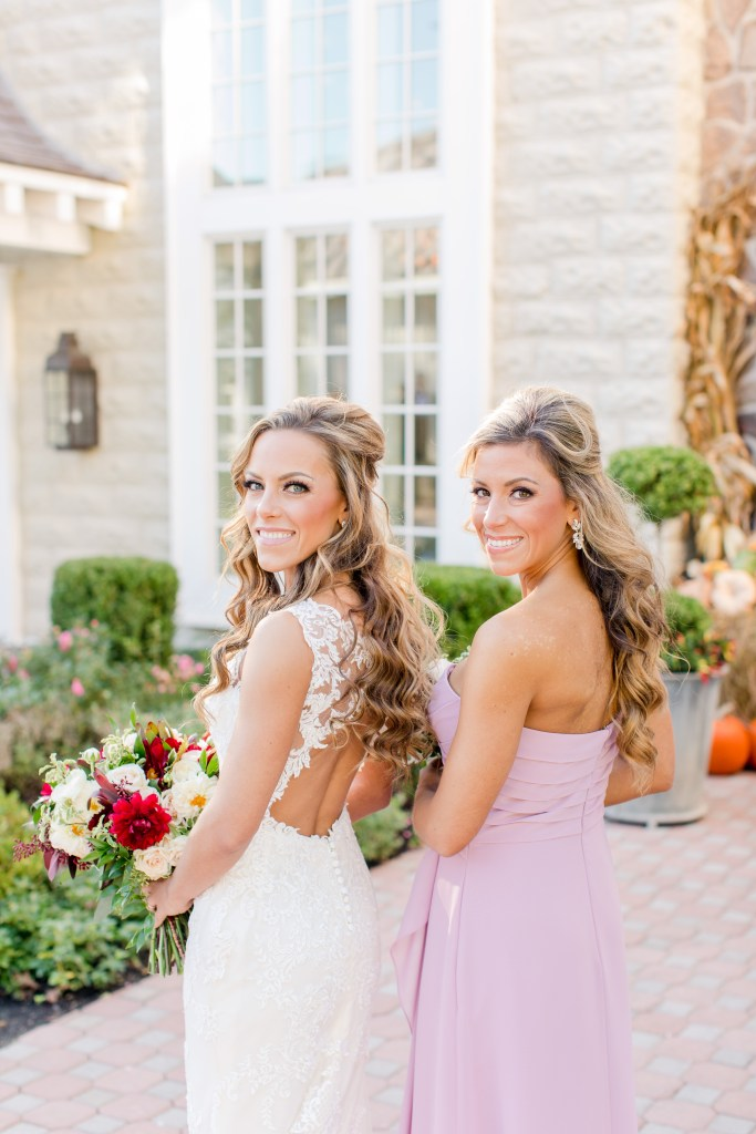 bride and sister, outdoor bridal party portraits, Ryland Inn, NJ wedding photographer