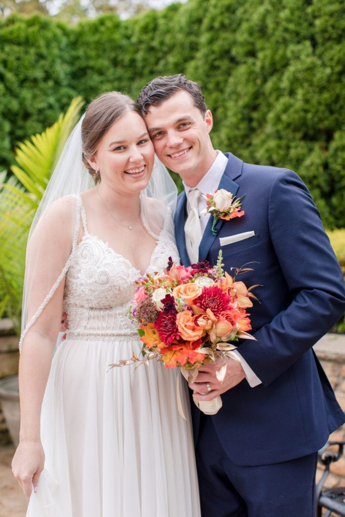 more formal smiling portrait of bride and groom outdoors