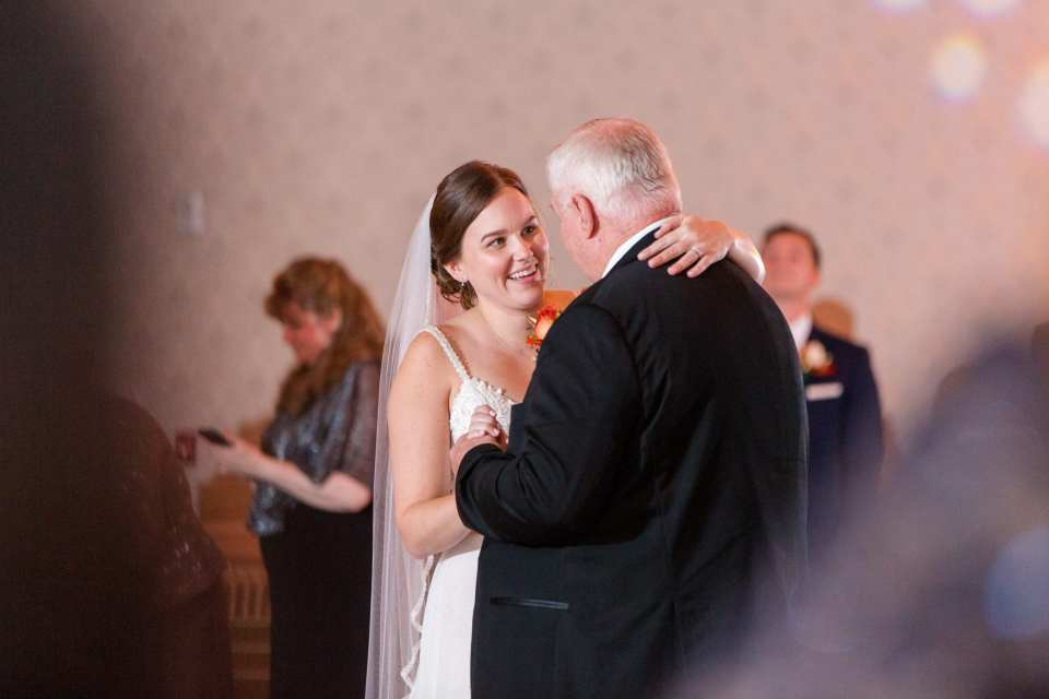 brides face during father daughter dance