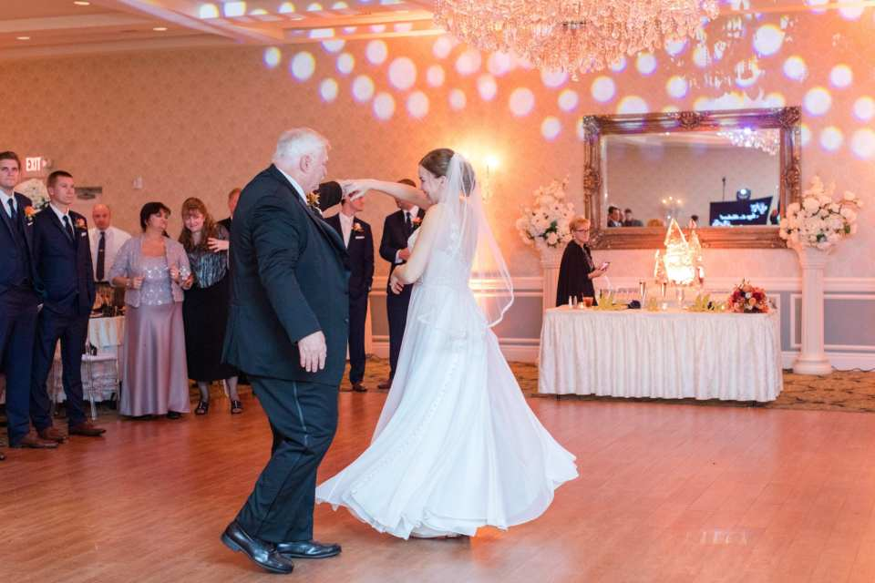 bride being spun by her father during the father daughter dance