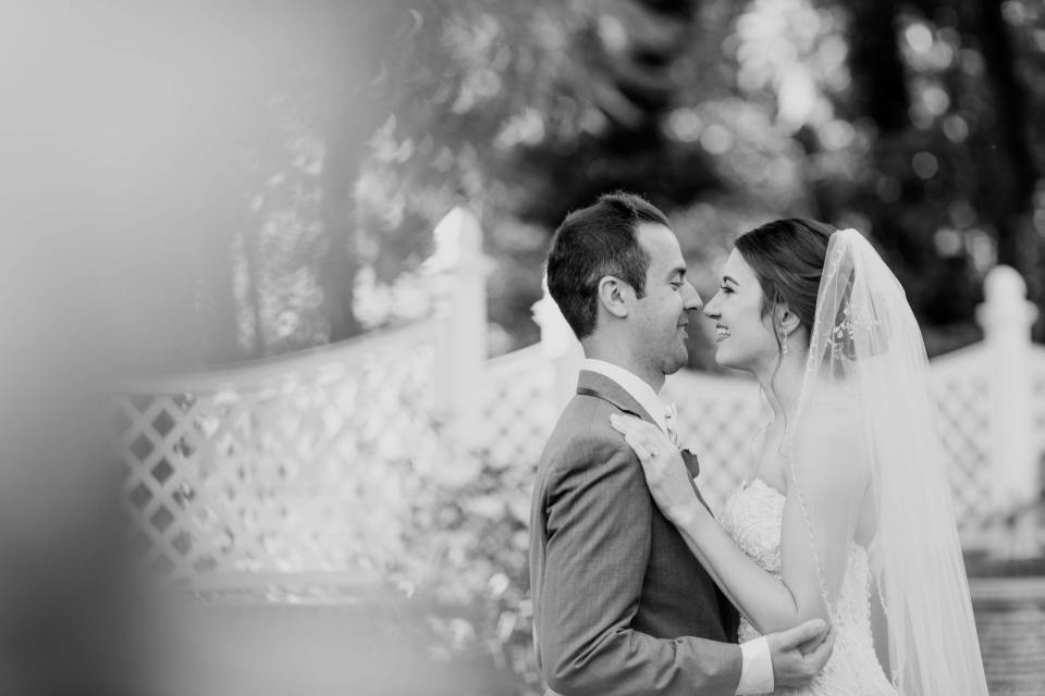 black and white photo of bride and groom gazing into each others eyes outdoors at Shadowbrook at Shrewsbury