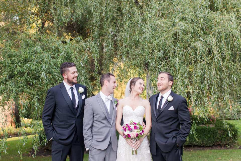 fun photo of bride and groom with groomsmen