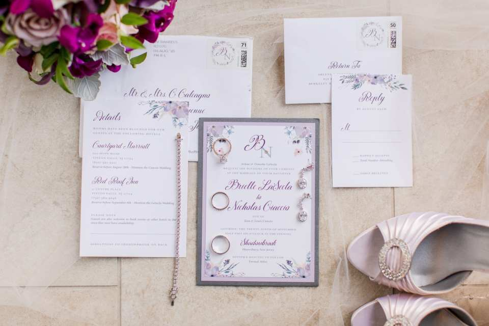 purple floral wedding invitation suite with bridal jewelry, shoes and bouquet