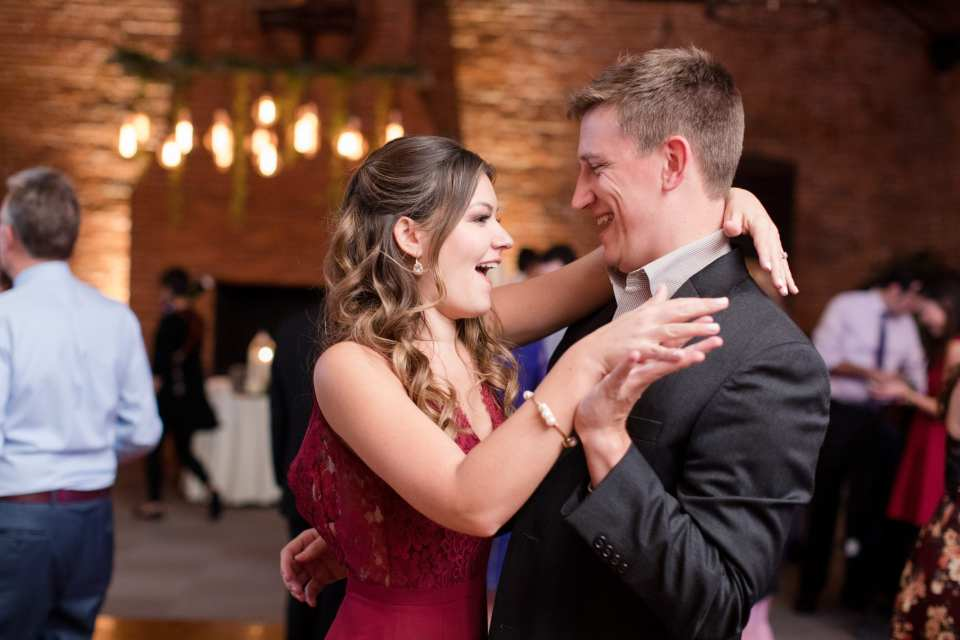 male and female guest dancing during wedding reception