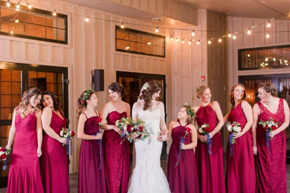 bride and bridal party in red gowns