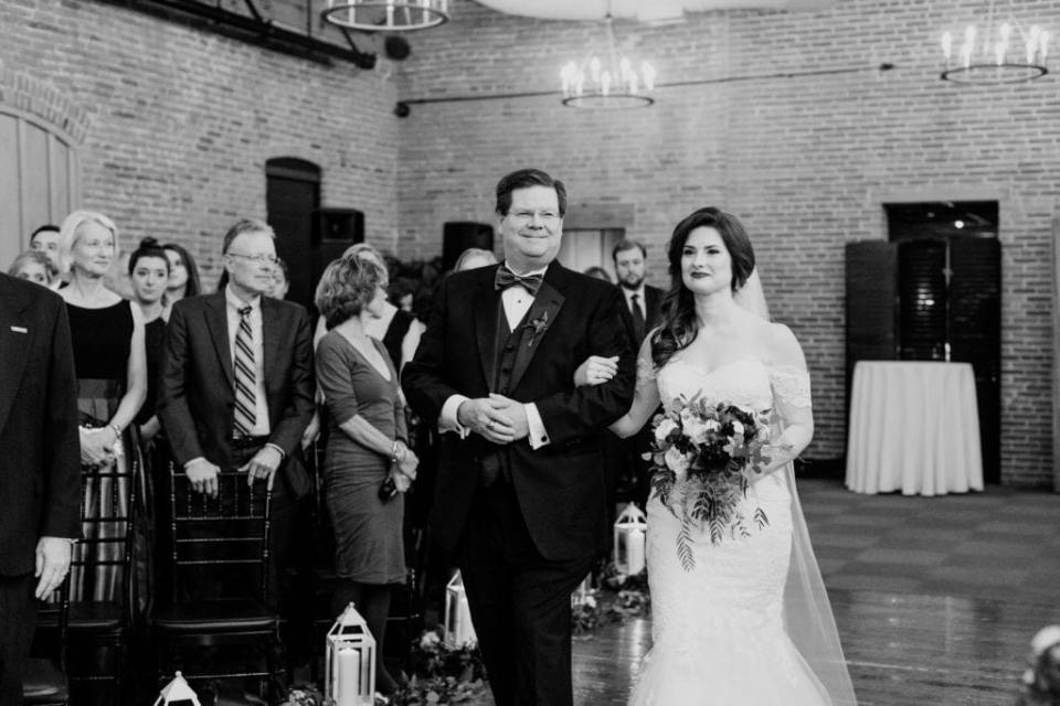 black and white photo of father of the bride walking bride down the aisle