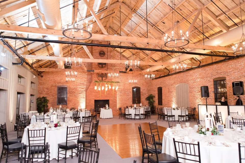 simple black chivari chairs with white linens and white candle lantern reception decor at the Cork Factory Hotel