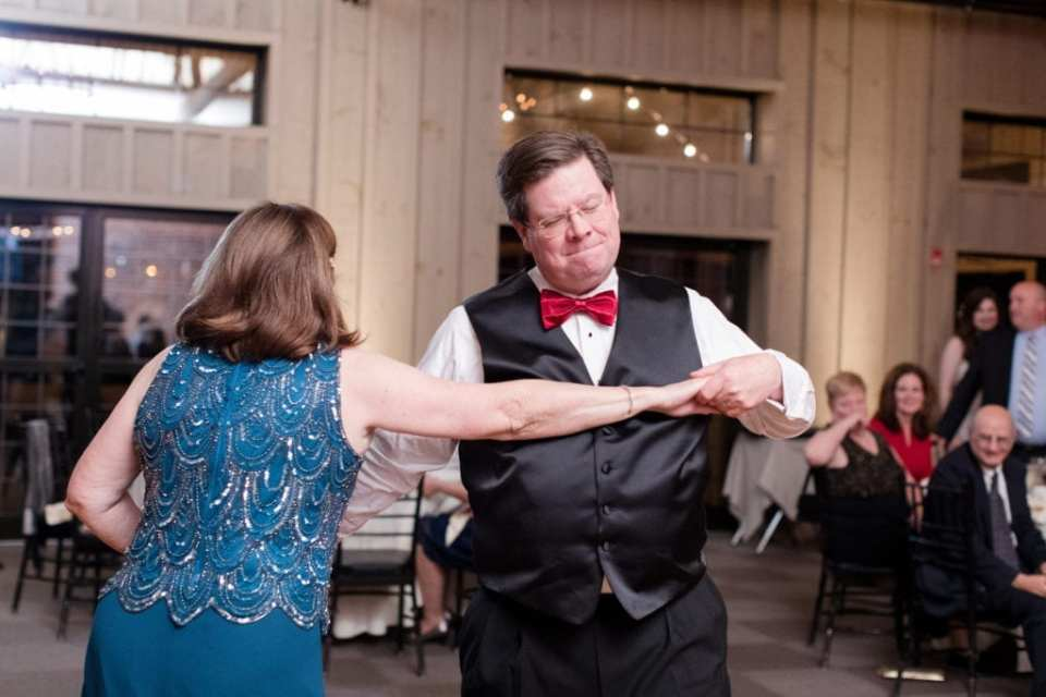 mother and father of the bride dancing during reception