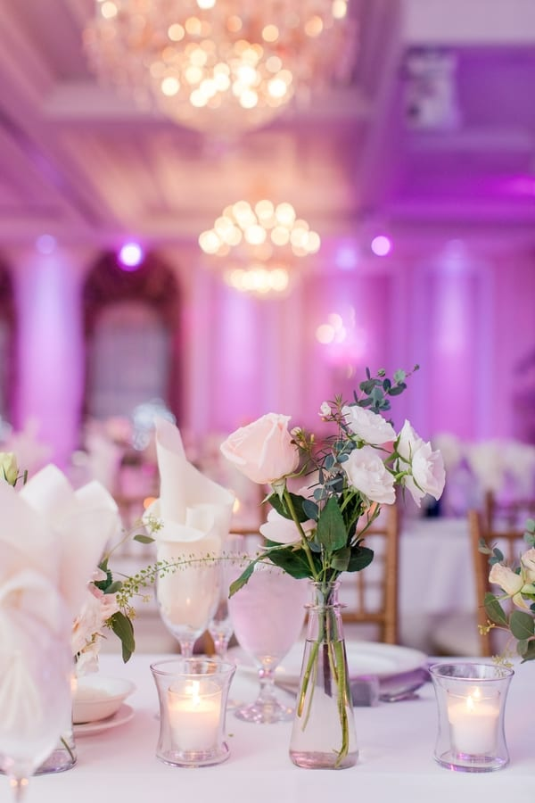 bud vases with small blush and white florals