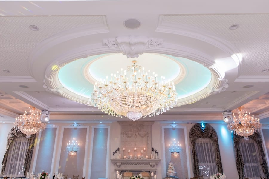 wide angle photo of chandelier hanging from ceiling in reception at the Primavera Regency