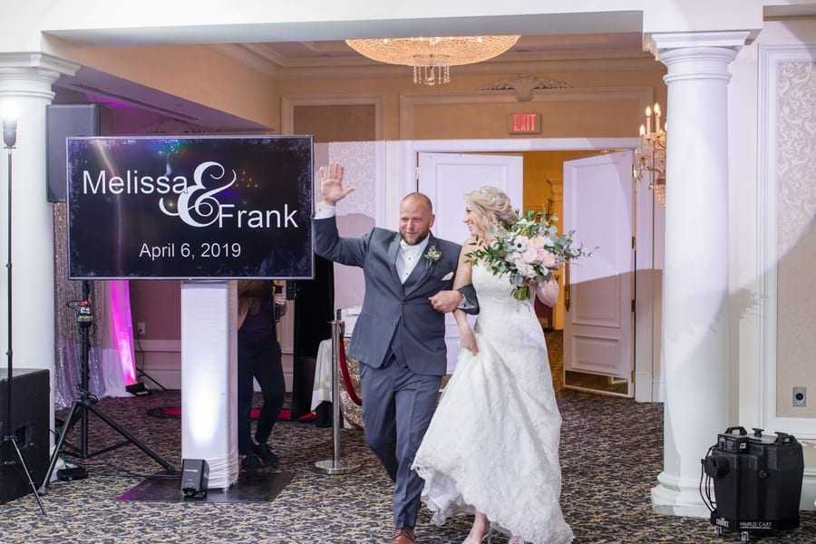 bride and groom making their grand entrance into their reception