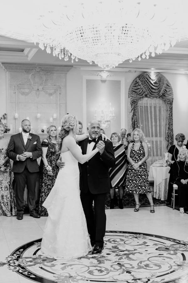 black and white photo of father of bride dancing with her