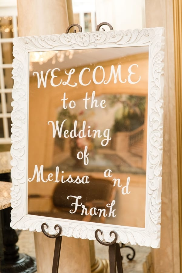 welcome to the wedding sign on mirror
