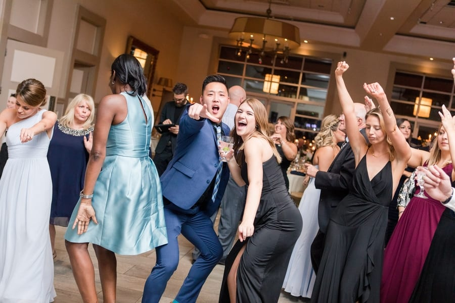 guests dancing and having fun during wedding reception