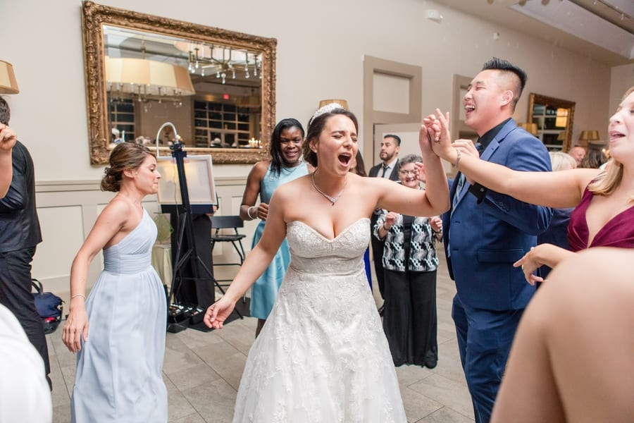 bride dances and sings during wedding reception