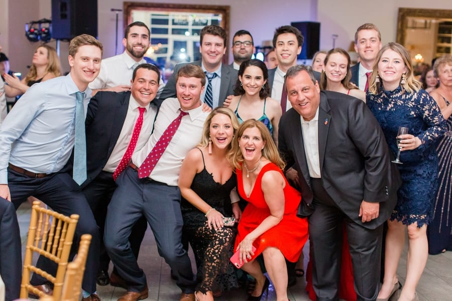 Guests pose for fun photo during wedding reception. One of the guests is former governor Chris Christie