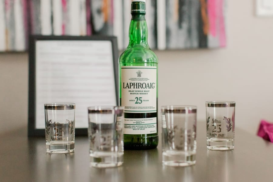 detail shot of Laphroaig 25 year old scotch bottle and shot glasses