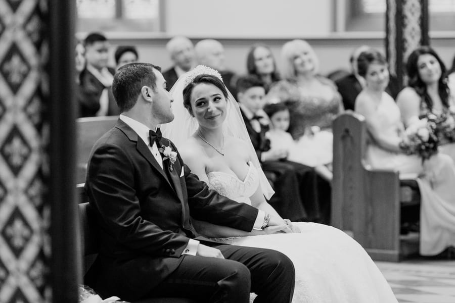 black and white photo catching a glimpse at each other during mass