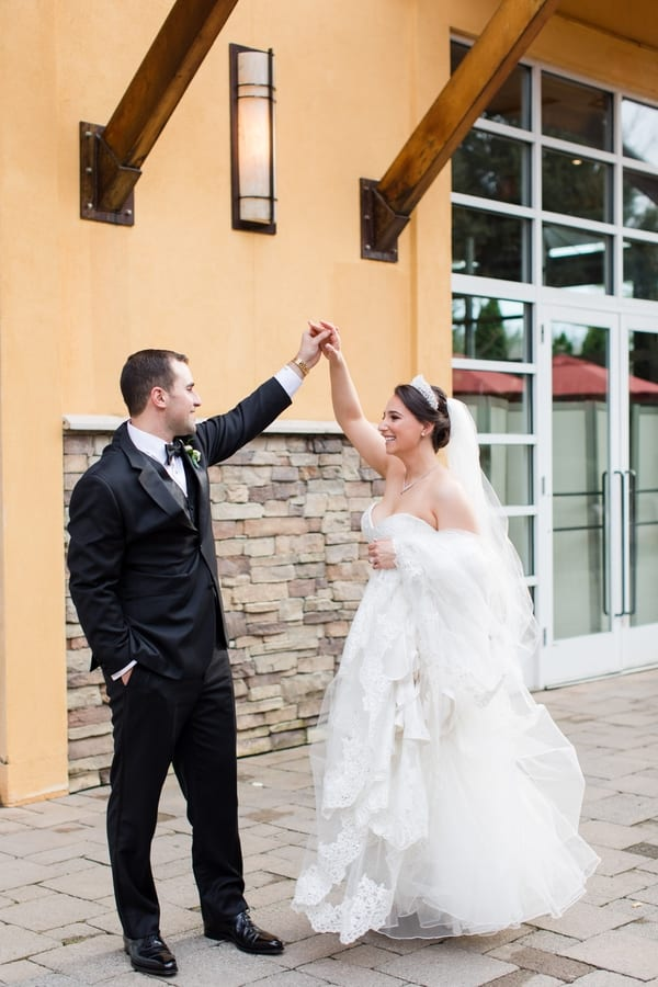 bride and groom portrait while they are dancing outside the Stone House
