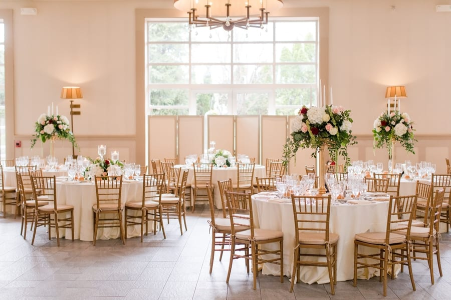 wide shot of multiple tables in reception room
