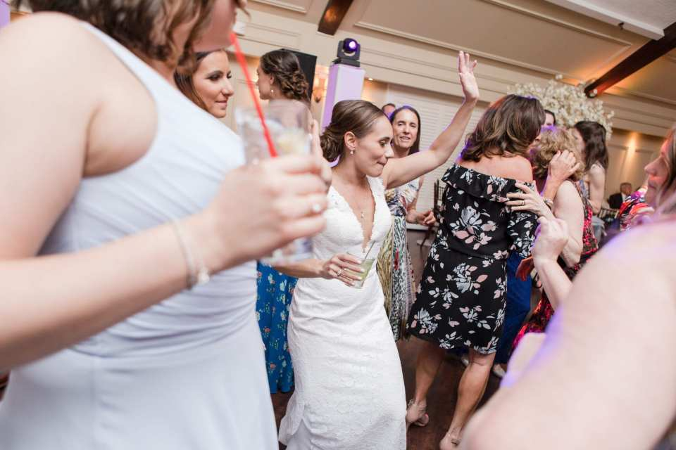bride in her Pronovias gown dances during the wedding reception, surounded by wedding guests