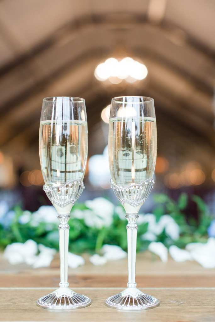 close up of the antique silver and crystal toasting flutes filled with champagne