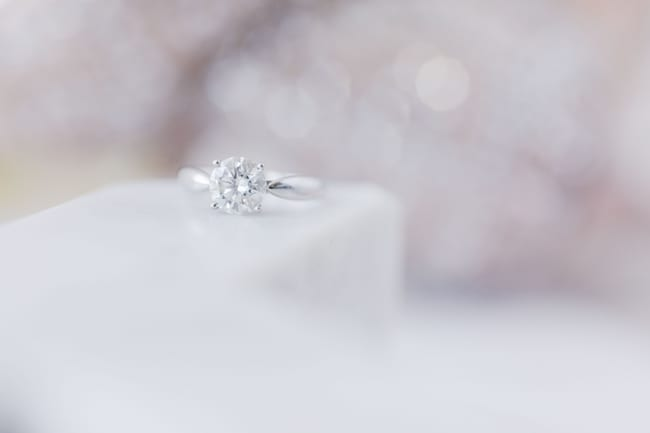close up of the brides round diamond engagement ring