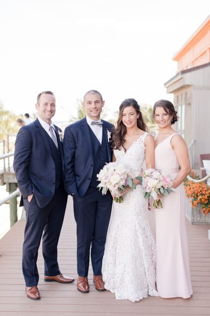 Bride and groom portrait with maid of honor and best man