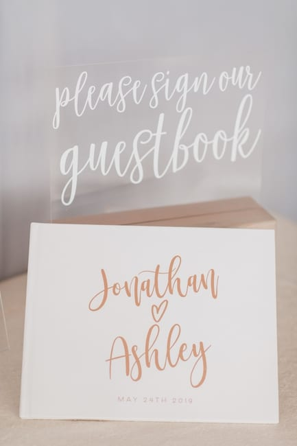 acrylic signage for the custom guestbook