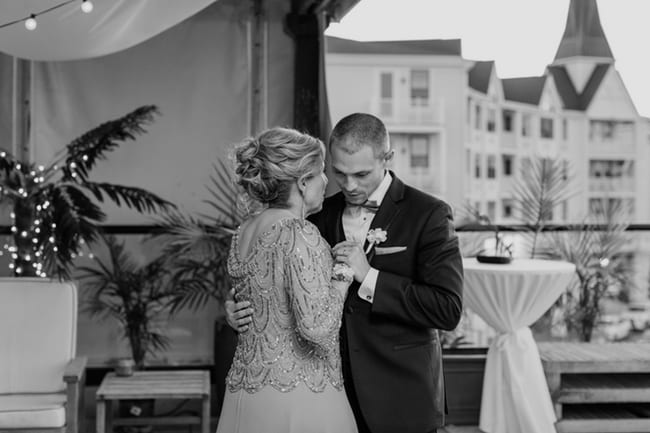 black and white photo of the groom and his mother dancing