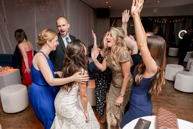 The bride dances with her guests during the reception