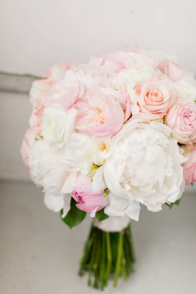 bridal bouquet of light pink and white peonies, roses and other assorted florals from the Flower Shop of Pennington Market