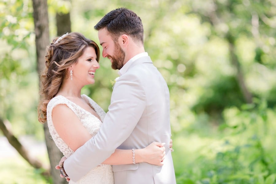 the bride and groom in a embrace while laughing gently with one another