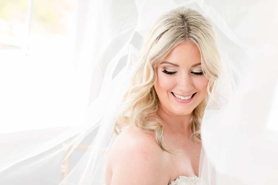 Formal portrait of the bride under her veil. Makeup by Michelle Elise Artistry